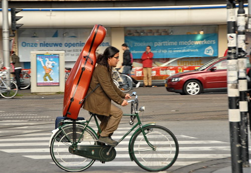 Man With Instrument On Bike