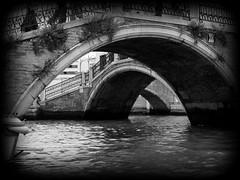 Bridges in Venice (pjink11) Tags: bridge venice blackandwhite italy stone europe bridges olympus 2006 blackdiamond e500 5photosaday venito zd1445mm blackwhitephotos theperfectphotographer
