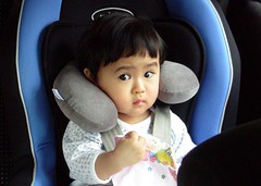 hey, who put this on my neck? (Satya W) Tags: baby car neck pillow carseat 2008 kirana 200803