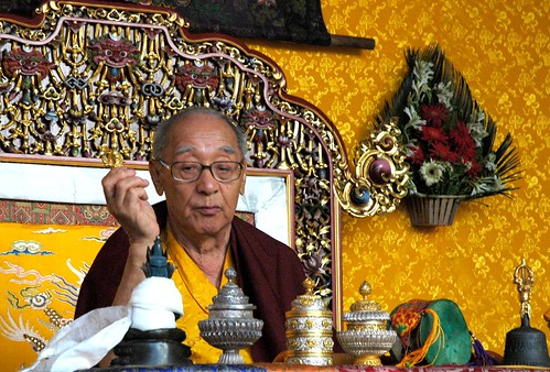 His Holiness JD Sakya holding a vajra, performing a puja (prayer), Tharlam Monastery, Boudha, Kathmandu, Nepal by Wonderlane