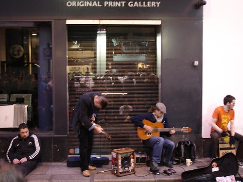 A lively traditional Irish folk band draws a crowd on the streets of Temple Bar.