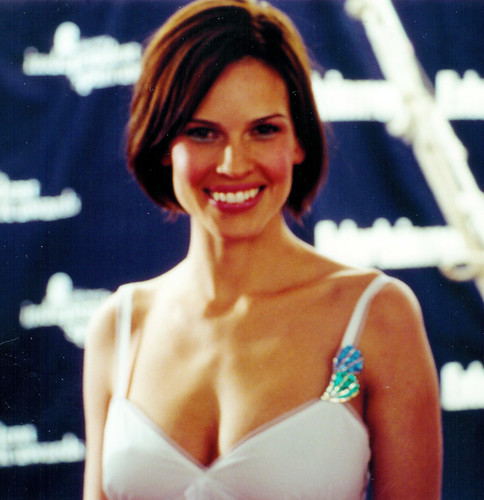 HIllary Swank's short bob hairstyle, brunette color, side part.