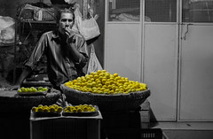 Lemons (relishedmonkey) Tags: nikon d5300 lemons kerala 35mm 18g fruit yellow selective colour color man single night lighting black white monochrome collection set round food outside sell trade market shop lines design