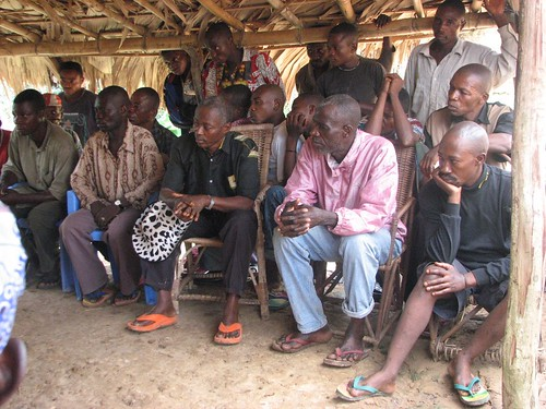 Everyone in Obenge listening attentively to Crispan as he presents TL2s ideas