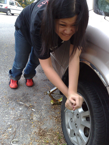 Removing a flat tyre.
