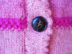 detail - pink cardi button