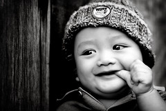Happy... (wazari) Tags: boy portrait blackandwhite baby monochrome smile face kids pose children bigeyes eyes nikon asia child emotion expression posing son myson malaysia emotional anakku melayu malay wajah anak potret 50mmlens nikond200 bwdreams availablelightphotography naturallightphotography anakkecil hitamputih haiqal wazari goldstaraward expressi aseankids