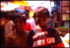 (rhythm n hues) Tags: street light india film beauty sunshine kids glow market teens innocence hyderabad pentaxspotmaticii kodakektachrome200 epsonv700 takumar50mmf14