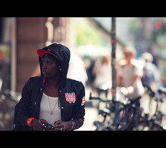 (graveur8x) Tags: street camera portrait orange black girl look canon germany deutschland cool photographer dof bokeh candid streetphotography style canon5d freiburg baseballcap 200mm strase primepipe