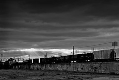 (Jim Merk) Tags: railroad sun graffiti industrial rays selfexpression fromtherooftop movinglight artandindustry meandmygang getoutoftown separatingclouds railwaytolight breakmethrough