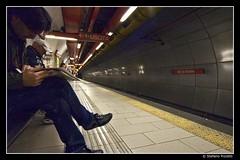 Re di Roma (Stefano Pizzetti) Tags: italy rome roma station yellow bench reading waiting italia metro exit romacaputmundi rediroma undergroundsandsubways imagoromae nikonclubitalia desafiourbano altraroma stefanopizzetti metropolitanametro