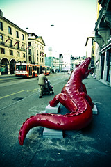 ~~ Born Wild, the symbolisation of our drives ~~ (Julien Ratel ( Júllí Jónsson )) Tags: street red fab sky people sculpture bus canon geneva geneve reptile contemporaryart apex crocodile artcontemporain eos350d themoulinrouge fpc blueribbonwinner firstquality mywinners abigfave platinumphoto anawesomeshot impressedbeauty diamondclassphotographer flickrdiamond megashot bornwild overtheexcellence thegoldenmermaid betterthangood theperfectphotographer thegardenofzen thegoldendreams goldstaraward dragongold blueju38 julienratel hannesplittone richardorlinski ungrosgroscrocrodile