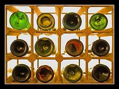 My Kind of Circles (Bawmer) Tags: glass bottles circles winerack sigma30mm14 d40 flickrchallengegroup flickrchallengewinner d40uktheme
