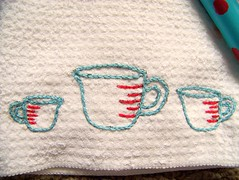 Tea Towel Swap-Embroidery close up (GoingSewCrazy) Tags: red kitchen crazy aqua sewing craft cups swap sublimestitching crafty spatula measuring teatowel swapbot embroidey