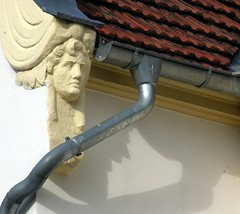 ... and he (:Linda:) Tags: roof shadow people man face germany town thringen leute decoration jena thuringia gutter he dach schatten dachziegel basrelief mensch dachrinne rooftile downpipe thuringian buildingdecoration dachschindel nonalivepeople