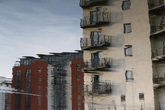 We're losing you (Geraint Rowland Photography) Tags: city uk blue red white reflection brick water wales living apartments balcony cardiff atlantic wharf waterquarter