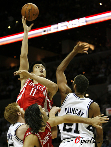 Yao Ming shoots a hook shot over Tim Duncan in the final preseason game for both teams on October 26th, 2007