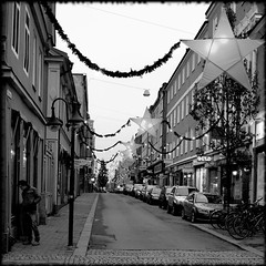 Morning Street 8 (R A Pyke (SweRon)) Tags: christmas street morning decorations blackandwhite bw man tree cars window shopping early sweden parked jul norrköping olympuse410
