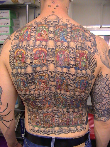 Full Back Tattoo of Skulls