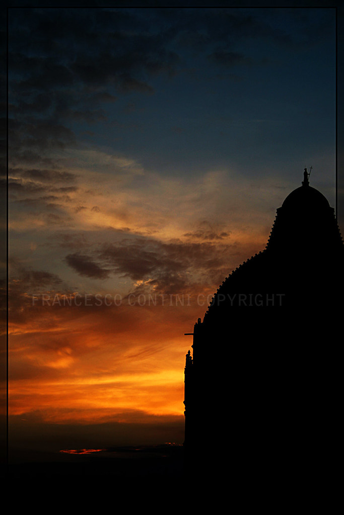 Sunset and baptistery silhouette