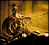 Holding horses (Yug_and_her) Tags: light horses sculpture man window metal bronze race greek 50mm miniature holding nikon shiny roman indoor surface riding oh veins hyderabad chariot newoffice d90 14f my infinestyle pixelloid boughtthisoneindubai forgotitatthehotelandwehadtorushbackfromtheairporttopickitup