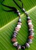 mzuri beaded necklace (Mzuri beads) Tags: bananaleaf barkcloth cowhorn paperbeads ethicalfashion ribbonnecklace recycledjewelry fairtradejewelry naturalbeads fairtradebeads ugandanbeads ecojewellery ethicalbeads mzuribeads ugandanjewelry kirstiemaclean