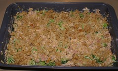 top with buttered bread crumbs