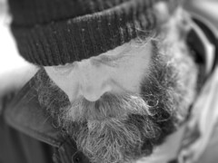 The Face of Homelessness () Tags: poverty people bw man galveston face beard paul island texas sad guitar tx homeless houston tourists seawall luck emotions galvestonisland mage homme mankind hardtimes indigent houstonist