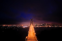 On the road to San Francisco (Penelope's Loom) Tags: sanfrancisco longexposure blue orange night boats bay nikon kaboom baybridge yerbabuena d300 yerbabuenaisland kfogkaboom 20x30 18200vr