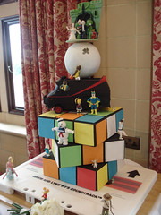 80's Themed Wedding Cake - Full View 1 (Alexandra Waite) Tags: wedding cake weddingcake barbie 80s sloth fraggle karatekid carebear smurf mrt themed doc goonies gizmo et teenwolf fragglerock ghostbusters indianajones gremlins ferrisbueller heman caddyshack backtothefuture mylittlepony rubikscube ateam bananaman rainbowbrite cassettetape superted staypuft cheerbear castlegrayskull 80scake 80sthemecake 80sweddingcake 80sthemedweddingcake 80sthemeweddingcake