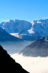 Bernina Massif and the foggy Valley (stefanrechsteiner) Tags: sky mountain berg schweiz switzerland flickr view glacier gletscher engadin graubünden grisons pizpalü