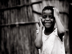 Maputo Girl (gunnisal) Tags: world africa street city portrait people bw girl child faces candid culture mozambique olympuse500 bwdreams aplusphoto