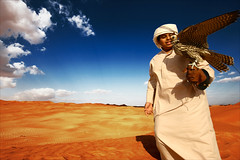 Falconry (mohammed al marzouqi) Tags: world blue sky yellow al eyes sand desert uae 123 mohammed falcon through abu dhabi falconry ain the my twtmeiconoftheday diamondclassphotographer flickrdiamond marzouqi