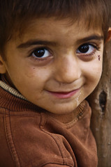 Small boy in the village (Izla Kaya Bardavid) Tags: boy portrait people color boys smile face smiling kids rural turkey children happy photo eyes village child mesopotamia turabdin assyrian syriac southeastturkey