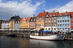 Summer in colorful Nyhavn (FP) (Osthollnder) Tags: summer reflection colors copenhagen geotagged denmark boats nyhavn colorful cloudy sommer july boote explore juli frontpage dnemark danmark kopenhagen 2009 farben reflektion friendlychallenge thechallengefactory