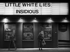 Little White Lies (Magic Pea) Tags: blackandwhite bw cinema london sunglasses lady night photography photo candid streetphotography streetlife shades walkingstick elderly unposed islington n1 screenonthegreen northlondon littlewhitelies magicpea insidous
