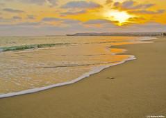 Sunset in Orange County (FrogMiller) Tags: ocean california ca sunset sea sky sun beach clouds pacific orangecounty theoc