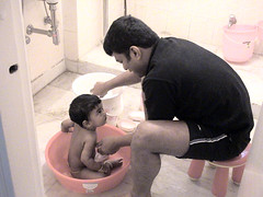 Bathing a baby Girl