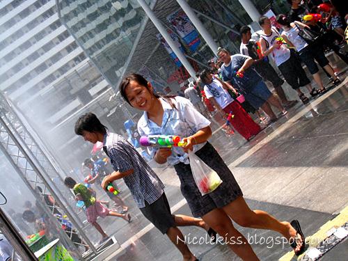 girl with water gun at water festival bangkok