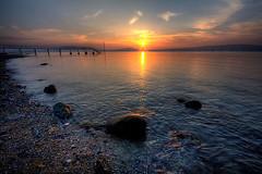 Cultra Sunset (DJScottieK) Tags: ireland sunset sea canon rocks northernireland digitalrebel ulster holywood cultra belfastlough supershot eos400d aplusphoto superbmasterpiece platinumheartaward