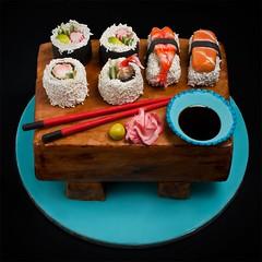 2nd attempt at a sushi cake... (Queen City Bakeshop) Tags: seaweed cake japan sushi japanese ginger rice salmon shrimp chopsticks nigiri soysauce wasabi woodgrain californiarolls dynamiterolls fauxwoodgrain sushicake