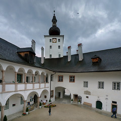 The arcaded courtyard of Schloss Orth (Bn) Tags: bridge flowers wedding mountain lake holiday mountains alps green castle sports water rain weather yellow clouds swimming geotagged island hotel austria wooden day hiking famous low marriage chapel courtyard palace rainy biking empire raining schloss salzkammergut upperaustria deepest gmunden orth traunsee schlossorth schlossort arcaded lakecastle seeschlossort landschlossort lakecastleorth tvseriesschlosshotelorth geo:lon=13792273 geo:lat=47911411