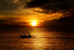serenity (tropicaLiving - Jessy Eykendorp) Tags: sunset sea sky bali seascape beach nature water silhouette yellow clouds indonesia geotagged photography golden boat asia glow panoramic serenity kuta smrgsbord golddragon mywinners abigfave anawesomeshot superbmasterpiece adoublefave naturessilhouettes tropicaliving tropicalivingtropicallivingtropicalliving panasoniclumixdmcfz8panasoniclumixdmcfz8 jessyce geo:lon=115157318 geo:lat=8817225