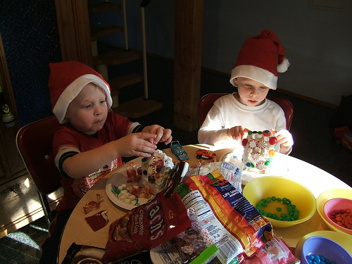 Cute little Christmas Elves, decorating houses