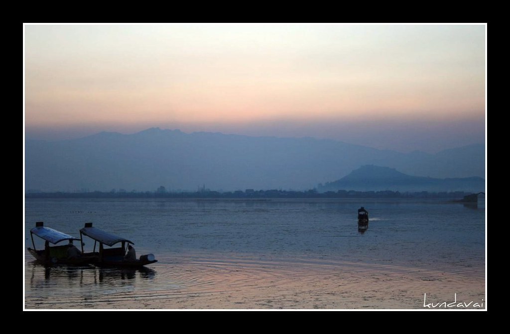 Boats at Dal lake during sunset