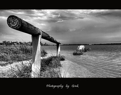 It will fade away...... (`Gink) Tags: sea blackandwhite bw cloud lake storm art grass rain composition photoshop canon paintshop rocks explore shore 5d bunbury faraway colourless shineon goldstaraward