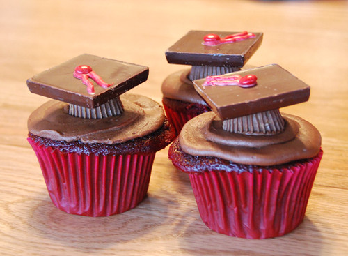 little chocolate cupcakes with graduation hats