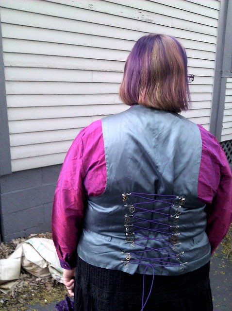 Corset-style lacing on the back of the vest