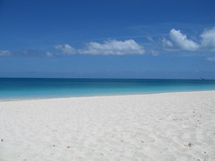 Grace Bay Beach - Turks and Caicos (cosmo-girl) Tags: sea summer sky lake seascape abandoned beach water rain clouds canon island nager solitude honeymoon seascapes turquoise empty dunes horizon shoreline tranquility cumulus 12 stranded turkscaicos deserted lamer archipelago drifting gulfstream carribeansea stillwaters tranquilscene whitesandbeach islandphoto desertisland purewhite laplage shipwrecked lonelybeach 12milebeach emptybeach carribeanocean toptenbeach caicosislands calmocean carribeanblue gracebay carribeanisland 12miles provodenciales carribeanwhitesand beautifulbynature tradewindclouds