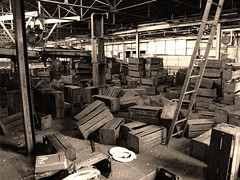 Photo of crates in a warehouse. Licensed under creative commons by Don Jones.